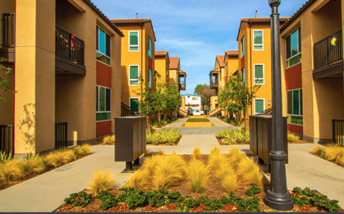 Condominiums With A Yellow Exterior